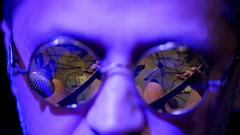 Rock-artist on concert - close up view face in mirror glasses, night club Stock Footage