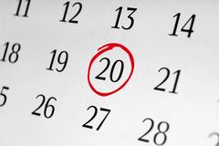 Mark the date number 20, focus point on the red marked number. Stock Photos