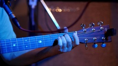 Musician playing acoustic guitar - guitar soundboard, telephoto Stock Footage