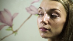 The pretty girl after the non-surgical correction of the shape of her nose. HD Stock Footage