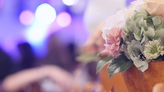 Floral decoration on the table grooms in the wedding hall where people Stock Footage