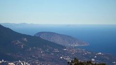 The city is located on the beach at the foot of the mountains Stock Footage