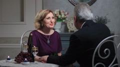 Senior man kissing woman's hand Stock Footage