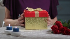Senior woman is surprised with gift from husband Stock Footage