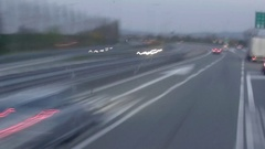 Timelapse with cars going the speed on a highway after dark 16p Stock Footage