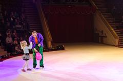 Tours of Moscow Circus on Ice. Clown with balloon and little girl Stock Photos