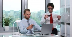 Confident Businessmen Browsing Website Shopping Online Workplace Office Interior Stock Footage