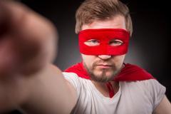 Super hero man making photos Kuvituskuvat
