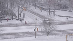 Aerial view of pedestrian crossing stree and traffic flow on cold blizzard snow Stock Footage