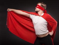 Young super hero man in studio Kuvituskuvat