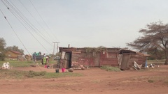 CLOSE UP: African people in traditional clothing in front of slum shanty house Stock Footage