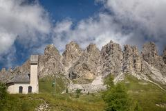 Little Church with mountains in the background Stock Photos