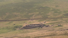 Tourists in safari jeep stopping at traditional maasai village near game park Stock Footage