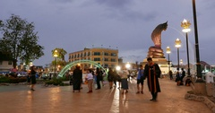 People roaming in the main square by night at Nakhon Phanom, Thailand. Stock Footage