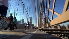 Pedestrians on Brooklyn bridge - Manhattan, New York city Stock Footage