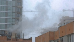 Winter cityscape. cranes. steam coming from the pipes Stock Footage
