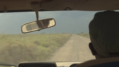 FPV: Safari guide game driving tourists on bumpy dusty road in national park Stock Footage
