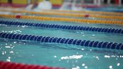 Swimming backstroke in a race Stock Footage