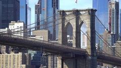Brooklyn Bridge pillar with Manhattan background - New York city Stock Footage