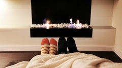 Couple Feet in Socks by Fireplace. Stock Footage