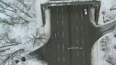 Cars driving on the highway in winter. The camera looks down. Aerial view. Stock Footage