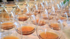 Glasses with whisky and cocktails stand in rows Stock Footage