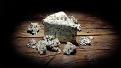 Danish Blue Cheese  with pieces rotating 360. Stock Footage