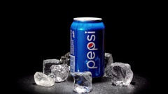 Pepsi jar whis ice rotates around its axis. Black background. 4k video. Stock Footage