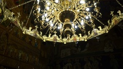 Gorgeous golden chandelier hangs under the ceiling in church Stock Footage