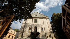 Look from outside at tall building of Catholic church with grey walls Stock Footage