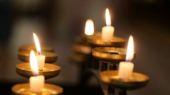 Bronze candleholders with burning white candles Stock Footage