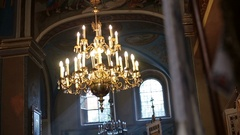 Golden chandelier hangs from the ceiling in church Stock Footage