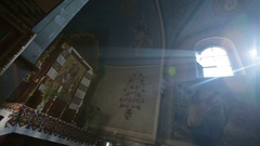 Rays of sun shine from windows in church Stock Footage