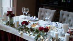Red autumn flowers decorate festive served dinner table Stock Footage