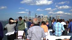 Staten Island ferry with passengers. New York skylines background - New York Stock Footage