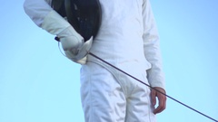 A man fencing on the beach, slow motion. Stock Footage