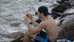 Young Man Taking Selfie with Cell Phone at Beach Stock Footage