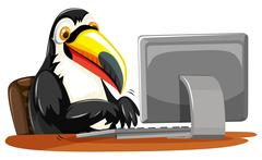 Toucan typing on keyboard Stock Illustration