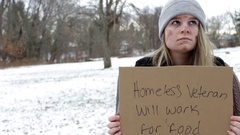 Man Walks by begging Homeless Veteran in local park during winter Stock Footage