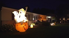 American suburb house decorated for halloween at night - Trick or treat party Stock Footage
