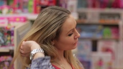 Portrait of a beautiful young mother in a supermarket toys Stock Footage