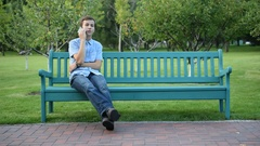 Teenager sitting on the banch talking the mobile phone Stock Footage