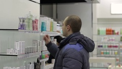 Man chooses gel for washing in the store. Stock Footage