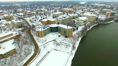 Scenic town and school buildings covered in fresh winter snow Stock Footage