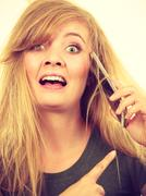 Crazy young woman talking on phone Stock Photos