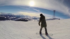 A young man snow boarding , slow motion. Arkistovideo