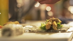 Cutting and Placing Tempura Shrimps Seen From the Side Stock Footage