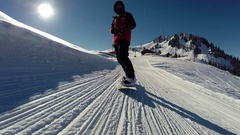 A young man snow boarding. Arkistovideo