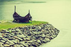 Old wooden viking boat in norwegian nature Stock Photos