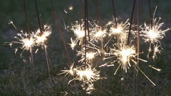A sparkler is a type of hand-held firework that burns Stock Footage